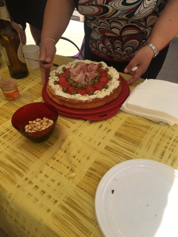 Savory cake with creme cheese, mozzarella, tomatoes, prosciutto, and olives. I loved this!!!