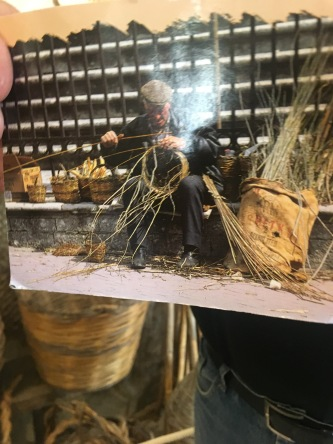 A picture of a postcard from the museum. This man was blind, but could basket weave by touch.